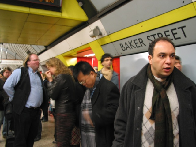Ethan, Fred and others awaiting the train to Canary Wharf for the Global Voices 2005 Summit in London.