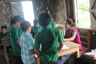 Teacher Sangpui Rose Merry Lusai is teaching some students of an individual class at School.                           Picture by : Suman Chowdhury Mony