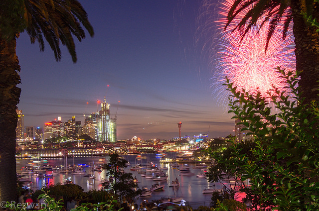 Sydney Harbour as seen from Lavender Bay, North Sydney - during New Year's Eve celebrations in 2015/2016. Photograph by Rezwan, shared on flickr, used under CC BY-NC-ND