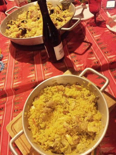 Paella and Chilean wine at friends' dinner table in Santiago, Chile. Photograph shared by @elicitizen on Twitter
